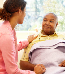 nurse talking to an elderly