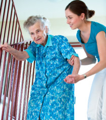 nurse aiding an elderly in the stairs