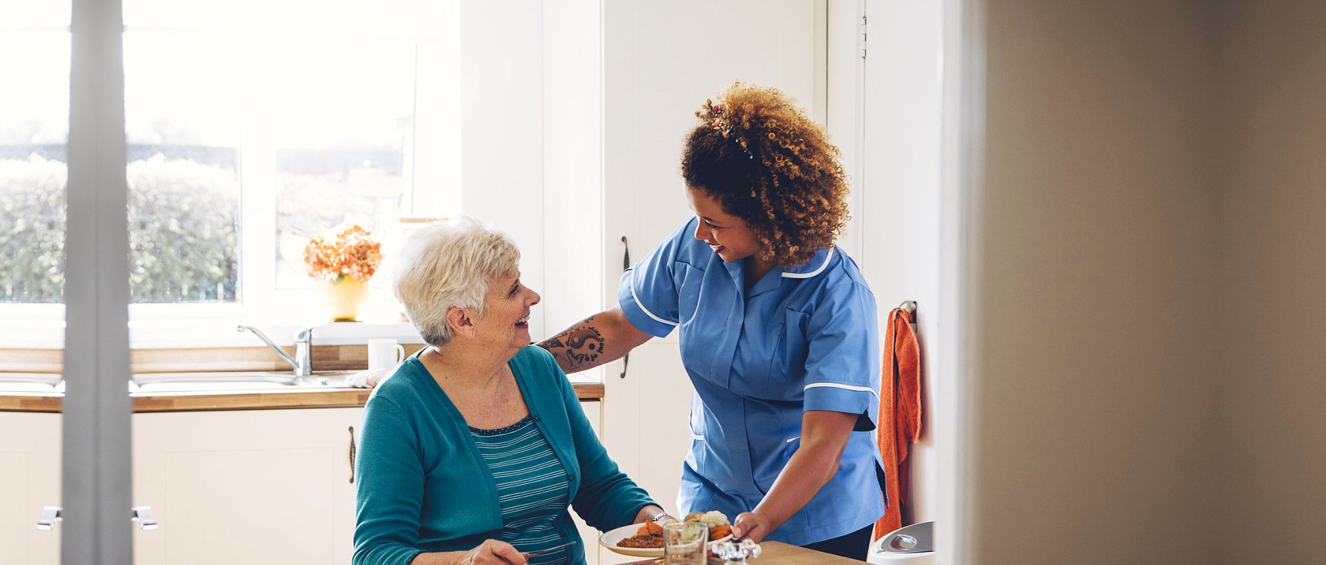 nurse smiling with an elderly woman
